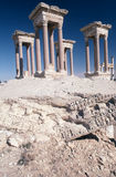 Tetrapylon at Palmyra Syria. Reconstructed tetrapylon at Palmyra, Syria. Pillars are reconstructions done somewhat amateurishly of coloured concrete. Palmyra is stock images