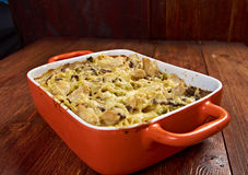 Tetrazzini is an American dish. Spaghetti with chicken, mushrooms and fresh grated parmesan cheese. baked noodle casserole Stock Photos