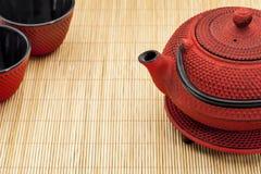 Tetsubin and tea cups Stock Photos
