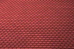 Tetto piastrellato rosso per uso del fondo Fotografia Stock
