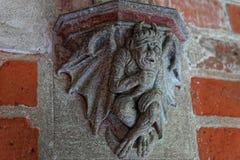 Teufel an der Toilette in Malbork-Schloss Stockbild