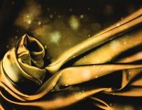 Teurer Goldseidenhintergrund Stockfoto