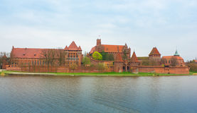 Teutonic castle Malbork in Pomerania region of Poland over Nogat Stock Photos