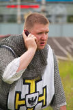 Teutonic knight with the mobile phone Royalty Free Stock Photography