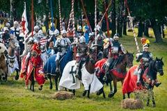 Teutonic Knights on horseback. Teutonic horsemen - 601th anniversary of Battle of Grunwald 1410. 4000 reenactors, 1200 knights, near 20 thousands of spectators Royalty Free Stock Images