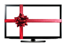 Tevê do diodo emissor de luz ou do LCD com a fita vermelha do presente do Natal Fotos de Stock Royalty Free