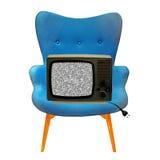 Tevê do vintage em uma cadeira azul Foto de Stock