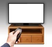 Tevê UHD 4K de Smart controlada pelo controlo a distância Imagens de Stock Royalty Free