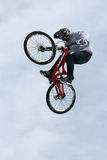 Teva Best Trick Bike. Trick bikes hit the big air jump at the base of Vail Mountain in Colorado during the first Winter Teva Mountain Games Royalty Free Stock Photography
