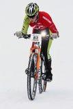 Teva en criterio de la bici de la nieve Imagenes de archivo