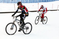 Teva On Snow Bike Criterium. With its short lap format, the Teva Mountain Games winter mountain bike criterium required cyclists to bike on a fast, snowy course Royalty Free Stock Image
