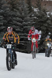 Teva On Snow Bike Criterium. With its short lap format, the Teva Mountain Games winter mountain bike criterium required cyclists to bike on a fast, snowy course Stock Image