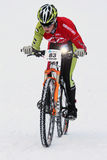 Teva On Snow Bike Criterium. With its short lap format, the Teva Mountain Games winter mountain bike criterium required cyclists to bike on a fast, snowy course Stock Images