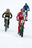 Teva On Snow Bike Criterium. With its short lap format, the Teva Mountain Games winter mountain bike criterium required cyclists to bike on a fast, snowy course Royalty Free Stock Images