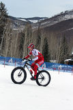 Teva On Snow Bike Criterium. With its short lap format, the Teva Mountain Games winter mountain bike criterium required cyclists to bike on a fast, snowy course Royalty Free Stock Photo