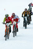 Teva On Snow Bike Criterium. With its short lap format, the Teva Mountain Games winter mountain bike criterium required cyclists to bike on a fast, snowy course Stock Photo