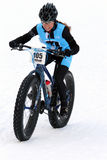 Teva sur le critère de vélo de neige Images libres de droits