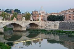 Tevere, Rome. Beautiful image of the Tevere, the basilica and the bridge Royalty Free Stock Photography
