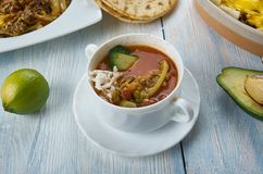 Tex-Mex Chicken Soup. Cooker Tex-Mex Chicken Soup, Tex-Mex cuisine, Traditional assorted dishes, Top view stock images