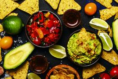 Tex-Mex Concept, Nachos, Guacamole, Salsa Sauce, Food Background. Top View stock photography