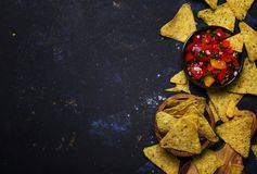 Tex-Mex Concept, Salsa Sauce, Tomatoes, Nachos and Lime, Food Ba. Ckground, Top View royalty free stock photo