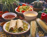 Tex Mex Food. Burritos. Tex Mex Food. Mexican burritos served with hot chili sauce and cheese dip Stock Photo