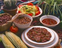 Tex Mex Food. Chili con carne stew. Tex Mex Food. Mexican Chili con carne served with hot chili sauce and pinto beans Royalty Free Stock Photo
