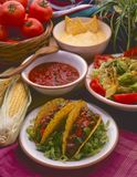 Tex Mex Food. Plate of tacos. Tex Mex Food. Mexican tacos served with hot chili sauce and cheese dip Royalty Free Stock Photos