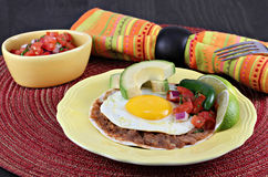 Tex Mex Huevos Rancheros, selective focus on egg Stock Image