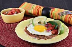 Tex Mex Huevos Rancheros, selective focus on egg Stock Image