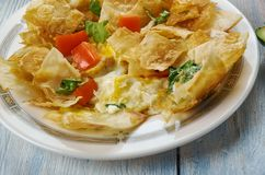 Tex-Mex Migas. Migas, Tex-Mex cuisine, diced onions, sliced chile peppers, diced fresh tomatoes, or cheese,, Traditional assorted dishes, Top view stock photos
