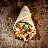 Tex Mex Wrap Stuffed with Meat and Vegetables. Close Up Still Life of Single Appetizing Tex Mex Fajita Stuffed with Chicken and Fresh Vegetables Wrapped in royalty free stock images