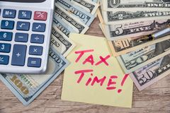 Tex tax time with calculator and money. On desk Royalty Free Stock Photography