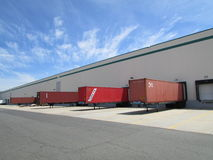 Tex, Turkon and CAI containers at warehouse doors in NJ, USA. Г. Containers of different shipping companies being loaded or unloaded NJ, USA Stock Image