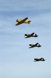 Texan & Nanchang Group Fly-By. Formation flying. Lead by the AT6 Texan. The three green coloured planes are Chinese Nanchang warbirds Royalty Free Stock Image