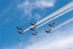 AT6 Texan Planes With Smoke Trails. EDEN PRAIRIE, MN - JULY 16, 2016: AT6 Texan planes with smoke trails at air show. The AT6 Texan was primarily used as trainer Stock Photo