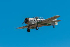 AT-6 Texan With Purple/Yellow Nose Flies By stock image