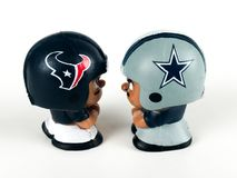 Texans v. Cowboys Li`l Teammates Toy Figures. Battle of Texas, Houston Texans v. Dallas Cowboys, Li`l Teammates Toy figures on a white backdrop Stock Photo