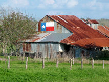 Texas Barn. An old barn proudly displays the Texas flag Royalty Free Stock Photo