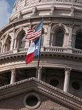 Texas Capitol with flags. Dome of the Capitol building of the State of Texas with waving flags royalty free stock photo