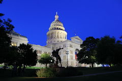 Texas Captial and cowboy. The Texas Capital building with a Texas cowboy in Austin Texas at dusk Royalty Free Stock Image