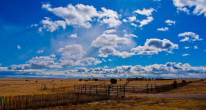 Texas Farm Lands in the Panhandle of Texas. Amazing clouds spot the sky when the farm and ranch land in texas get some great weather stock image
