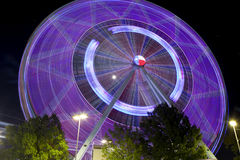 Texas Ferriswheel (night). Ferris wheel at the Texas State Fair in Dallas TX in action. Motion blur - long exposure Royalty Free Stock Images