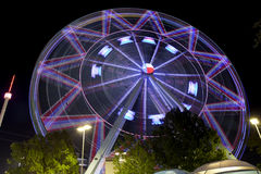 Texas Ferriswheel (night). Ferris wheel at the Texas State Fair in Dallas TX in action. Motion blur - long exposure Stock Photo