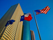 Texas flag. Skyscraper with a Texas and American flag in downtown, Houston, Texas stock photo