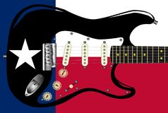 Texas Flag Below A Rock And Roll Electric Guitar. Texas flag background pattern with an electric rock and roll guitar superimposed Royalty Free Stock Photos