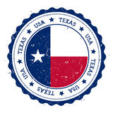 Texas flag badge. Grunge rubber stamp with Texas flag. Vintage travel stamp with circular text, stars and USA state flag inside it. Vector illustration Stock Image