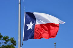 Texas Flag. On the mast waving in the wind royalty free stock photos