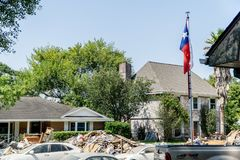 Hurricane Harvey Aftermath. Texas flag outside of a Houston area home devastated after Hurricane Harvey royalty free stock images