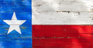 Texas flag painted on rustic weathered wooden boards. 